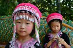 Girls in traditional dress in northern Thailand - Wat Phra That Doi Suthep